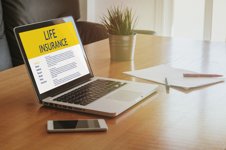 Laptop computer with Life Insurance contract in the screen.